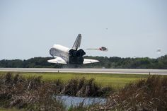STS133-S-113 (9 March 2011) --- Space shuttle Discovery's main gear touches down on Runway 15 at the Shuttle Landing Facility at NASA's Kennedy Space Center in Florida. Landing was at 11:57 a.m. (EST) on March 9, 2011, completing a more than 12-day STS-133 mission to the International Space Station. Onboard are NASA astronauts Steve Lindsey, commander; Eric Boe, pilot; Steve Bowen, Alvin Drew, Michael Barratt and Nicole Stott, all mission specialists