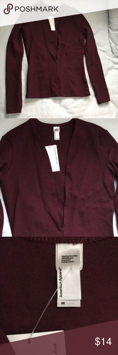 American Apparel Long Sleeve Tight fitting low cut top from American apparel. New with tags. Maroon. Size medium. American Apparel Tops