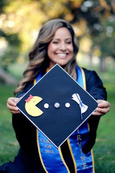 My graduation cap in Rhinestoned Ms. Pacman cap-- made by yours truly.