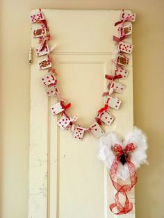 Valentine's Day Playing Card and knotted fabric garland is a great way to add pops of red while decorating.  Thrift stores are full of fabric sources, and playing cards :)