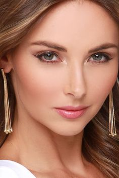 """Our dearly beloved accessory of the season? The Gathered Here Today Gold Earrings! Gold tube beads gather snake chain strands with spherical ends forming chic, dangling earrings. Earrings fall 3.25"""" from post backs. Man made materials. Imported."""