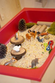 Fall forest woodland themed animal sensory play - dry oatmeal, pinecones, acorns & cinnamon sticks, cardboard tubes, wood slices, etc.