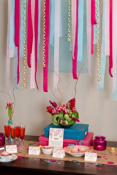 This bridal shower idea used crepe papers as its backdrop. Hot pink and turquoise are beautiful bridal shower color combination