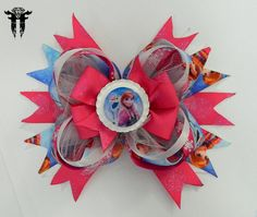 """*~*~* Frozen Inspired """"Anna & Olaf"""" Hair Bow *~*~*            This super cute Anna & Olaf inspired hair bow measures approximately 6 x 5 inches!!  Stacked and stacked with printed grosgrain ribbon and shimmery tulle, it`s a perfect accessory for your Frozen fan! I have sealed them in a bright white flattened bottle cap to the center of the bow. They are protected by an epoxy dome that slightly magnifies the design- bringing it to life!"""