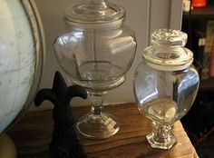 Dollar store glass jar + dollar store glass candle stick = cute apothecary jars!