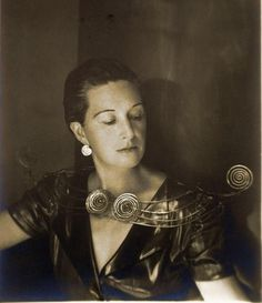 Photo by Imogen Cunningham of Margaret Schevill wearing a neck piece and earrings created by Alexander Calder in 1950.