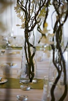 "curly willow arrangements with ""falling"" floral daisy accents - tall arrangements for 7 guest table and additional accent arrangements.like but tall arrangements at seated dinners are not a favorite Non Floral Centerpieces, Branch Centerpieces, Wedding Centerpieces, Wedding Decorations, Centrepieces, White Centerpiece, Centerpiece Flowers, Centerpiece Ideas, Wedding Bells"