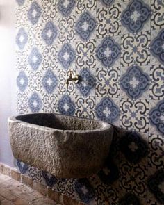 Swoon... I love the marriage of the rough hewn concrete and beautiful tile  #walls