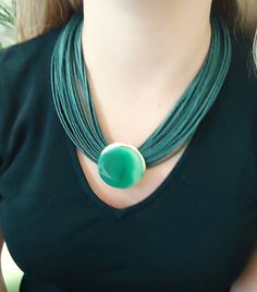 Necklace in fiber with green  agate stone. Metals gold plated. by CRISDONATI on…
