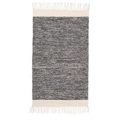Ferm Living Melange Rug Black Adorn your floors with this hand woven thick, warm and soft cotton melange rug. Classic mix of black and white, graphic design with soft fringe detailng. Perfect for bathrooms floors or anywhere in the home where y