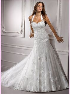 Never thought of a halter for a wedding dress... but it's very cute!