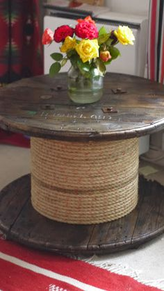 Reel table pirate/nautical style complete with rope core to make it look like a capstan. For sale or hire www.OverTheMoonTents.com
