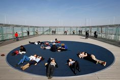 Tourists and Parisians take advantage of warm temperatures in the French capital by relaxing on top of the Montparnasse Tower in Paris, March 16, 2012 (Francois Mori/Associated Press)