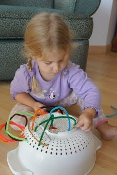 pipe cleaners and a colander will also keep toddlers occupied. Pipe cleaners and a strainer.develops motor skills & keeps them occupied for hours!Pipe cleaners and a strainer.develops motor skills & keeps them occupied for hours! Indoor Activities, Infant Activities, Summer Activities, Childcare Activities, Summer Crafts, Diy Crafts For Kids, Fun Crafts, Baby Crafts, Toddler Crafts
