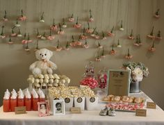 Idea: Use inexpensive flowers (carnations) and some twine to create a soft backdrop for the dessert table. Adorable! #desserttable #babyshower #readytopop
