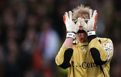 Vladimir Rys / Oliver Kahn of Bayern reacts during the Bundesliga match between Alemannia Aachen and Bayern München at the Tivoli stadium on February 17, 2007 in Aachen, Germany.