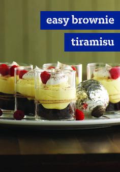 Easy Brownie Tiramisu – Coffee, raspberries, and sweet cream cheese take brownies to an even yummier level in this easy-to-make tiramisu dessert recipe.