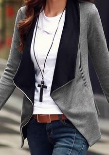 Front view of model in grey oblique zipper cardigan
