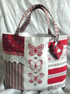 Inspiration for using a piece of trim I love for the center of a bag (in place of the butterflies)