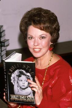 Shirley Temple ---- This book about her life that she's holding in her hand was absolutely fascinating. ... Worth reading !!!!