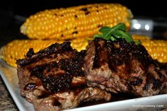 Grilled Garlicky Steak with Corn on the Cob - This grilled steak recipe is seasoned to perfection with a garlic-onion topping. Corn on the cob serves as the shining sidekick to each grilled steak, creating a wholesome summertime meal.