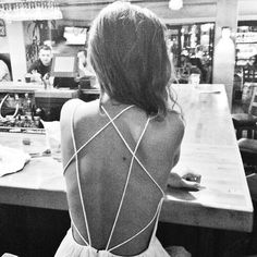 Strappy backless dress. Pretty details.                              …
