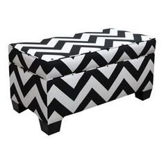 "Wrapped in chic chevron upholstery, this handmade storage ottoman features plush foam padding and a pine wood frame. Product:  OttomanConstruction Material:  Solid pine frame, polyurethane foam and polyester fillColor:  Black and whiteDimensions:  18"" H x 36"" W x 18"" D Cleaning and Care:  Spot clean only"