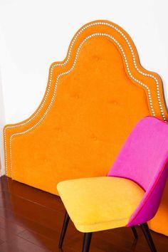 Bright orange studded headboard | Miss Lolo