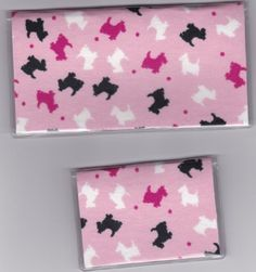 "Scottie Puppy Dog Toss Pink Checkbook Cover Set by Tickled Pink Boutique. $9.50. Fun and functional for every day use without paying a designer price for a designer name!  The sturdy clear PLASTIC 12 gauge lightweight VINYL COVER encases a fabric bonded design. Measuring 6 1/4"" x 3 1/4"",  the checkbook cover fits all standard bank checkbooks and banking registers.  All checkbook covers come with a register flap and a duplicate check flap just like the bank.    The drivers li..."
