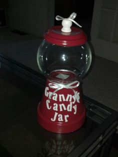 Candy Jar!!  Supplies: Clay flower pot with drain dish, glass globe/bowl from craft section  wood knob also found in craft section, choice of paint (spray paint was used in pic above)  hot glue gun. Optional: ribbon  lettering  Basic: Use flower pot as base, glue globe/bowl, then use drain dish as lid with wood knob on top!  Then just get creative!