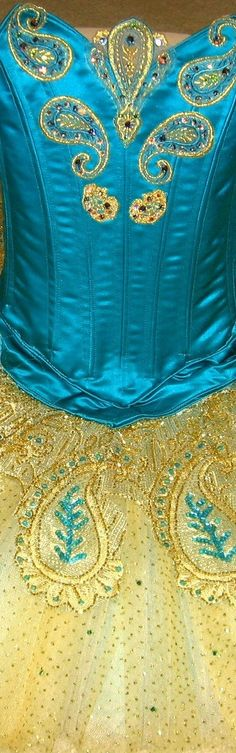 Turquoise and gold tutu bodice. To follow more boards dedicated to dance photography, pas de deux, little ballerinas, quotes, pointe shoes, makeup and ballet feet follow me www.pinterest.com/carjhb. I also direct the Mogale Youth Ballet and if you'd like to be patron of our company and keep art alive in Africa, head over to www.facebook.com/mogaleballet like us and send me a message!