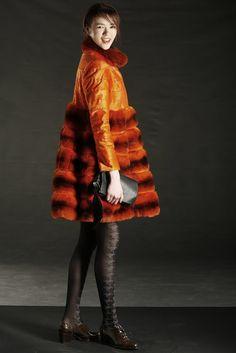 Fall 2013 Trend: Fun Fur All (Dennis Basso's broadtail and chinchilla coat. Diane von Furstenberg bag; Leg Apparel tights; Stuart Weitzman shoes.)