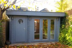 Contemporary garden office log cabin, painted grey, with neat integral store room & fun porthole door. long glazing to the front face ensures plenty of light. Backyard Garden Landscape, Small Backyard Gardens, Large Backyard, Small Garden Office, Garden Office Shed, Balcony Garden, Garden Planters, Tropical Backyard, Modern Backyard
