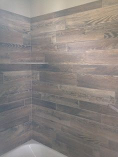 Bathroom tub surround done with wood tile turned out gorgeous! Such a unique look!