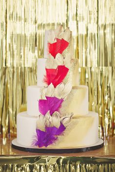 We're speechless! #gold #feathers #cake   Photography: www.cleanplatepictures.com   Design: http://michelleferrarahandmade.com