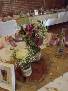beautiful simple jam jars filled with gyp and natural flowers on wood www.weddingflowersbylaura.com  www.pimhillbarn.co.uk