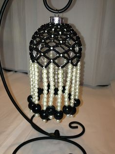 Hand beaded Ornament cover with fringe black by FromOneEmptyNest