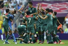 Mexico's players celebrate their victory over Brazil after their men's soccer final gold medal match at Wembley Stadium during the London 2012 Olympic Games