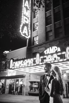 Outdoor, Nighttime, Downtown Tampa Bride and Groom Wedding Portrait at Tampa Theatre Marquee   Tampa Wedding Photographer Marc Edward Photographs
