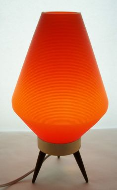 Rare Vintage Mid Century Modern Atomic Orange Lamp Eames Era Danish Modern Teak Legged Tri-Pod Base Space Age Table Lamp Lighting. $119.00, via Etsy.