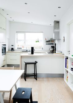 Stunning renovation of a family house. Beatifull white and wood kitchen