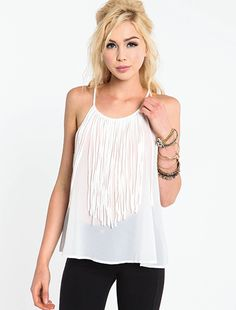 I love white and I love fringe. Dress up with cute skirt, dress down with high waisted shorts.