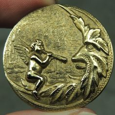 BRASS PICTURE BUTTON ~ CHERUB PIPING TO THE MAN IN THE MOON.
