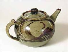 """Danlami Aliyu teapot - 10"""" (254 mm) long, 5½"""" (139 mm) high. This was thrown by Danlami and decorated by Michael OBrien In the early days at Maraba the two did throwing and decorating turn-and-turn-about on a weekly basis."""