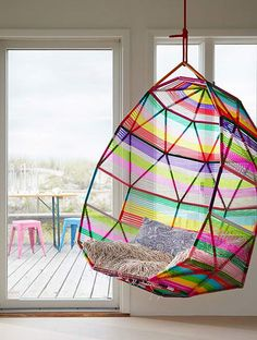 I could make this hanging chair by welding rods together and adding fabric. Oh man!