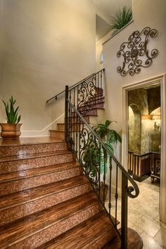 Mosaic tiles on stair risers with wood floor