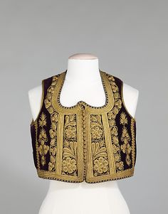 The well-balanced designs on this vest are handsomely executed and show the strong influences of the Ottoman Empire. The raised couching gives the motifs an organic and vital appearance.