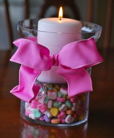 Valentine's Hurricane Vases- Hurricane jars, Conversation Hearts, Candle and pretty bow is all it takes to make this cute decoration.