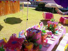 The colorful grass skirt risers are a fun feature Aloha Party, Hawaiian Luau Party, Hawaiian Theme, Tiki Party, Kids Luau Parties, Teenage Parties, Luau Birthday, Birthday Parties, Birthday Ideas