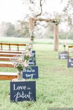 Outdoor wedding ceremony decor - love quotes as aisle markers {Amy Maddox Photography}